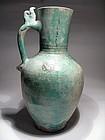 Islamic Turquoise Glazed Clay Jug, 1100-1200 AD.