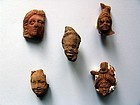 Group of Five Egyptian Terracotta Heads
