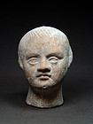 Etruscan votive head of a child, 3rd/2nd century BC
