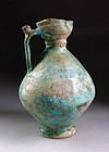 Beautiful Islamic Nishapur jug with torquise glaze, 900 AD.