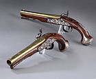 Pair of Wilson Brass Barrel and Silver Mounted pistols c. 1760