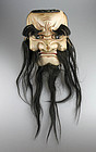 A rare early Japanese wooden Noh mask w hair, 19th. century