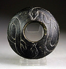 Rare Mesopotamian black stone macehead with snakes, 3rd. mill BC