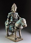 Ming Dynasty blue glazed pottery horseman officer with sword