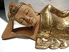 Fine hand carved wooden reclining Buddha with gilding