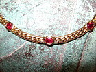 Solid Gold 18K. Necklace set with 7 Deep Red Genuine Rubies