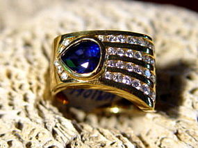 Solid 18K. Gold Ring set with Blue Sapphire & Diamonds