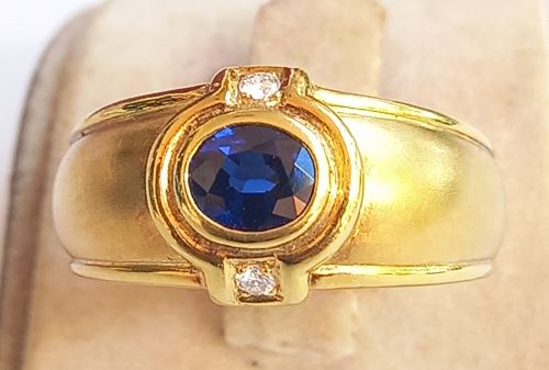 Solid 18 K. Gold Ring with Blue Sapphire & Diamonds
