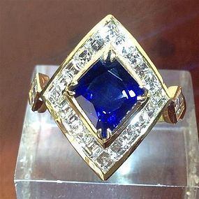 Stunning Fancy Cut Blue Sapphire Ring with Diamonds