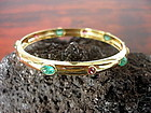 18K. Gold Bangle-Bracelet set with Emeralds and Rubies