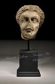 Ancient Roman marble female head, 100 - 300 AD