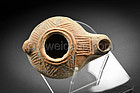 Roman Imperial pottery oil lamp depicting Bacchus, 1st