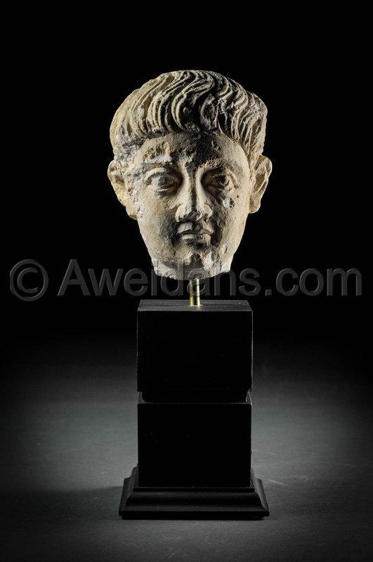 Limestone head of a youth, Roman Palmyra, 1st Century A.D