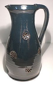Temmoku Glazed Jug With Impressed Waffle Decoration