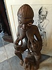 Early 20thc Yoruba African Wood Sculpture Mother Feeding Twins