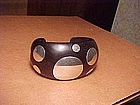 EXCEPTIONAL WILLIAM SPRATLING ROSEWOOD SILVER DOT CUFF