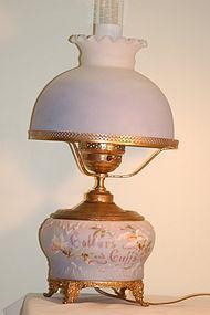 Wavecrest glass C.F.Monroe 'Collars & Cuffs' lamp C:1890