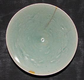 A Korean moulded celadon bowl. Koryo period.