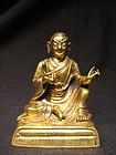 A Sino-Tibetan gilt bronze figure of a lama. 18th c.