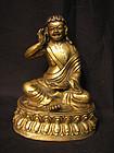 A fine Sino-Tibetan gilt bronze figure of Milarepa.