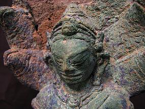 A Javanese bronze figure of buddha with makalinda.