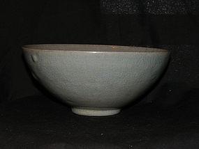 A Korean celadon moulded bowl. Koryo period, 12th c.