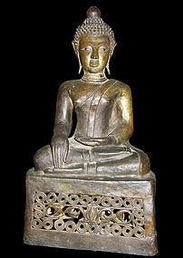A Thai or Laos gilt-bronze figure of a seated Buddha.