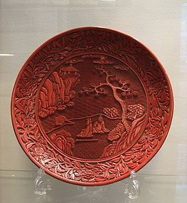 A rare Chinese carved cinnabar lacquer landscape dish.