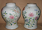 A pair of large famille rose jars.