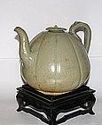A rare Korean celadon ewer and cover.