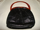 MID-CENTURY BLACK LEATHER HANDBAG W/ LUCITE HANDLE