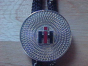 VINTAGE INTERNATIONAL HARVESTER ADVERTISING BOLO