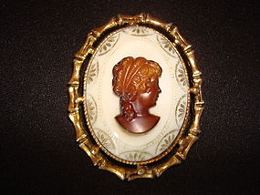 1960'S GLASS CAMEO IN BAMBOO DESIGN GOLD TONE FRAME