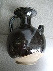 A Chinese phosphatic and treacle brown glaze stoneware