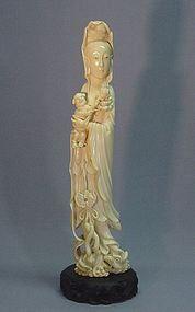 CHINESE IVORY CARVING OF GUAN YIN WITH CHILD