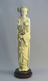 CHINESE CARVED IVORY STATUE OF A MAIDEN