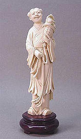 CHINESE CARVED IVORY GIRL HOLDING A BASKET