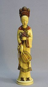 JAPANESE POLYCHROME IVORY CARVING OF A FEMALE FIGURE