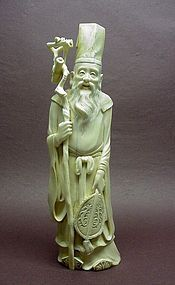LATE MEIJI PERIOD IVORY CARVING OF A SAGE