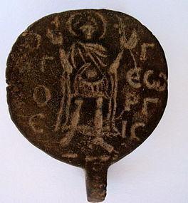 A BYZANTINE BRONZE AMULET OF ST. GEORGE