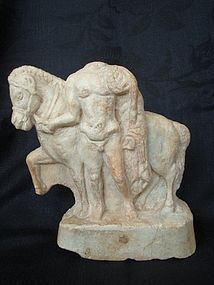 A GREEK MARBLE FIGURE OF A HORSE AND DISMOUNTED RIDER