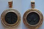 A JEWISH BRONZE COIN OF SHIMON BAR-KOCHBA IN 14K GOLD