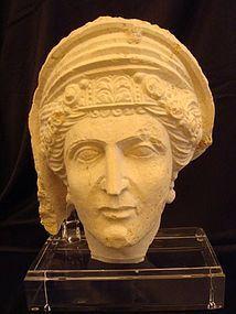 A PALMYRENE LIMESTONE HEAD OF WOMAN