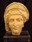 A PALMYRENE LIMESTONE HEAD OF WOMAN
