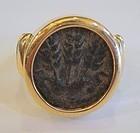 A BRONZE PRUTAH OF HEROD AGRIPPA I IN A 14K GOLD RING