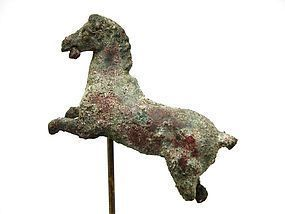 A HELLENISTIC BRONZE FIGURE OF A HORSE