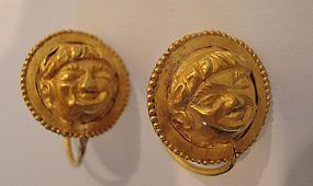 A PAIR OF LATE HELLENISTIC GOLD EARRINGS WITH FACE OF EROS