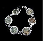 SIX NABATAEAN BRONZE COINS IN SILVER BRACELET