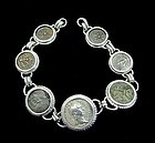 SIX BRONZE HOLY LAND PRUTOT AND DENARIUS OF TRAJAN IN SILVER BRACELET