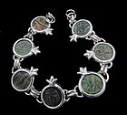 SEVEN PRUTOT FROM ROMAN JUDAEA IN SILVER POMEGRANATE BRACELET